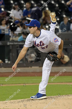 New York Mets pitcher Seth Lugo delivers the ball to the Colorado Rockies during the eighth inning of a baseball game, in New York
