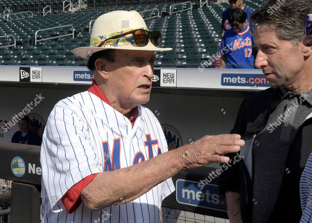 Former professional golfer Chi Chi Rodriguez talks with New York Mets owner Jeff Wilpon, right, before a baseball game against the Colorado Rockies, in New York