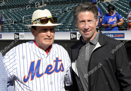 Former professional golfer Chi Chi Rodriguez poses with New York Mets owner Jeff Wilpon, right, before a baseball game against the Colorado Rockies, in New York