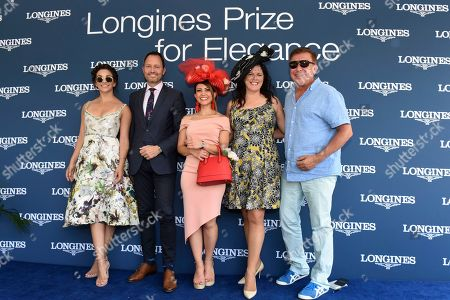 Elham Ayati, center, of New York, celebrates after winning the Longines Prize for Elegance fashion contest, with judges, from left to right, actress Ana Villafane, Pascal Savoy, Longines US Brand President, Christine A. Moore, of Christine A. Moore Millinery, and Forbes fashion editor Joseph DeAcetis, at Belmont Park in Elmont, NY. Longines, the Swiss watchmaker known for its elegant timepieces, is the Official Timekeeper and Watch of the 151st running of the Belmont Stakes