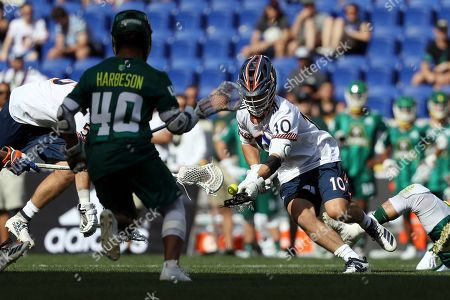 Archers' Stephen Kelly tries to get control of the ball during a Premier Lacrosse League game against the Redwoods on in Harrison, N.J