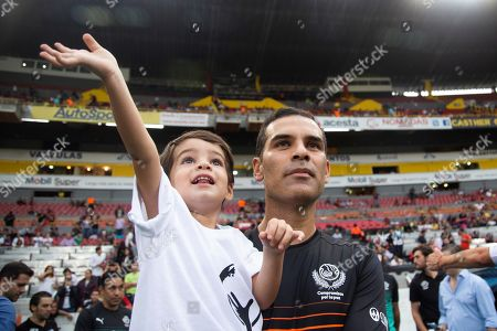 Former Mexican soccer player Rafael Marquez (R) holds his son during the 'Farewell of Legend, Commitments for Peace' friendly soccer game at the Jalisco Stadium in Guadalajara, Mexico, 08 June 2019.