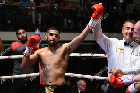 Muheeb Fazeldin (black/red shorts) defeats Jamie Quinn during a Boxing Show at York Hall on 8th June 2019