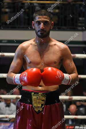 Stock Picture of Muheeb Fazeldin (black/red shorts) defeats Jamie Quinn during a Boxing Show at York Hall on 8th June 2019