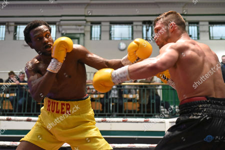 Stock Image of Adrian Redman (yellow shorts) defeats Harry Matthews during a Boxing Show at York Hall on 8th June 2019