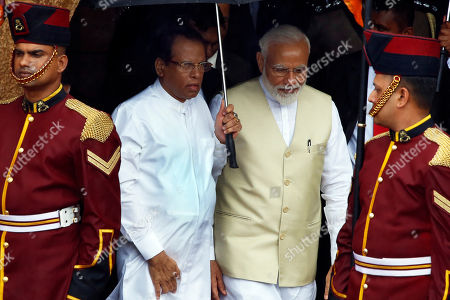 Sri Lankan President Maithripala Sirisena (C-L) is accompanied by visiting Indian Prime Minister Narendra Modi (C-R) at the Presidential Secretariat at Galle Face in Colombo, Sri Lanka 09 June 2019. Indian Prime Minister Narendra Modi arrived on the island for a short visit after touring the Maldives. This visit to Sri Lanka is his second international visit, since becoming Prime Minister of India for the second term.