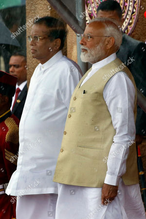Indian Prime Minister Narendra Modi (R), Sri Lankan President Maithripala Sirisena (L) during the guards of honor at the Presidential Secretariat at Galle Face in Colombo, Sri Lanka 09 June 2019. Indian Prime Minister Narendra Modi arrived on the island for a short visit after touring the Maldives. This visit to Sri Lanka is his second international visit, since becoming Prime Minister of India for the second term.
