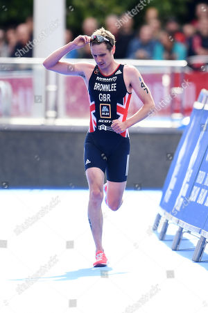 Alistair Brownlee of Great Britain shows a look of dejection upon finishing the Men's Elite race.