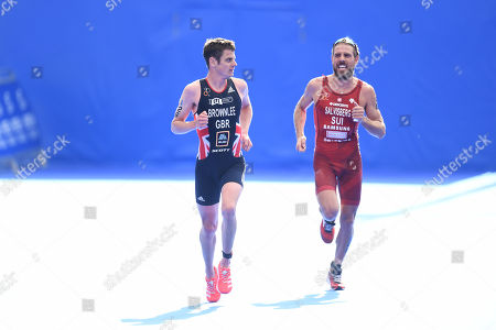 Jonathan Brownlee of Great Britain is overtaken by Andrea Salvisberg of Switzerland upon finishing the Men's Elite race.
