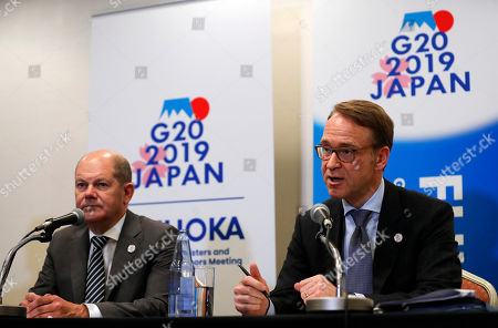German Finance Minister Olaf Scholz (L) and German Bundesbank President Jens Weidmann (R) attend a news conference during the G20 Finance Ministers and Central Bank Governors Meeting in Fukuoka, southwestern Japan, 09 June 2019. The G20 finance ministers and central bank governors meeting is taking place in Fukuoka on 08 and 09 June.