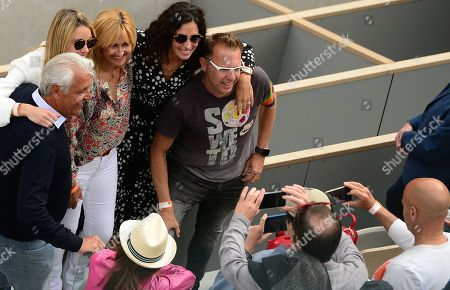 Maria Isabel Nadal (2L), sister of Rafael Nadal, Ana Maria Parera (3L), mother of Nadal and Xisca Perello (4L), girl friend of Nadal, pose after Rafael Nadal of Spain won the men?s final match against Dominic Thiem of Austria during the French Open tennis tournament at Roland Garros in Paris, France, 09 June 2019.