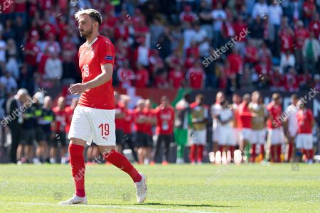 Switzerland's forward Josip Drmic reacts after missing his penalty shot during the UEFA Nations League third place soccer match between Switzerland and England in Guimaraes, Portugal, 09 June 2019.