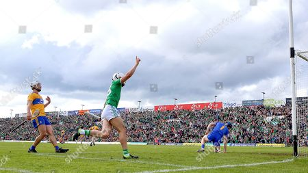 Limerick vs Clare. Limerick's Aaron Gillane celebrates scoring his sides goal as Clare's Patrick O'Connor and goalkeeper Donal Tuohy look on dejected