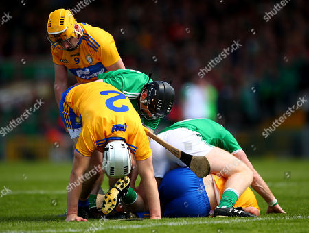 Limerick vs Clare. Clare's Colm Galvin and Patrick O'Connor and Jack Browne with Graeme Mulcahy and Cian Lynch of Limerick