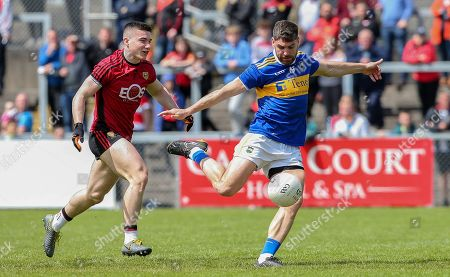 Down vs Tipperary. Down's Daniel McGuinness and Tipperary's Philip Austin