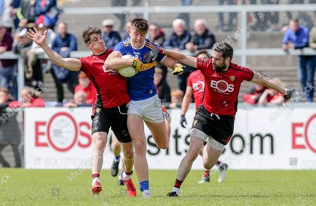 Down vs Tipperary. Down's Conor Poland and Kevin McKernan with Tipperary's Steven O'Brien