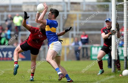 Down vs Tipperary. Down's Darren O'Hagan and Tipperary's Michael Quinlivan