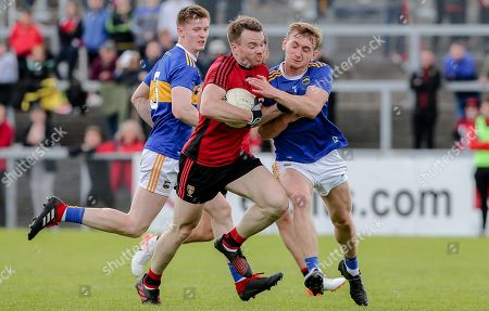Down vs Tipperary. Down's Brendan McArdle and Tipperary's Daire Brennan