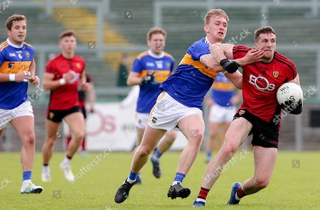 Down vs Tipperary. Down's Johnny Flynn and Tipperary's Daire Brennan