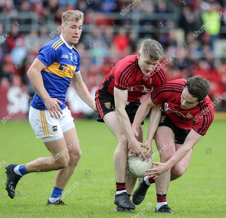 Down vs Tipperary. Down's Conor Maginn and Cory Quinn with Tipperary's Paul Maher
