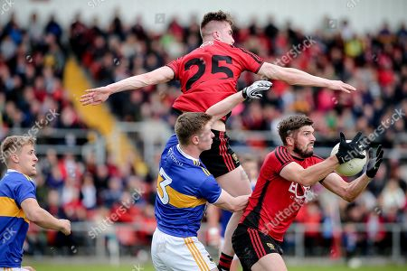Down vs Tipperary. Down's Connaire Harrison and Tipperary's John Meagher