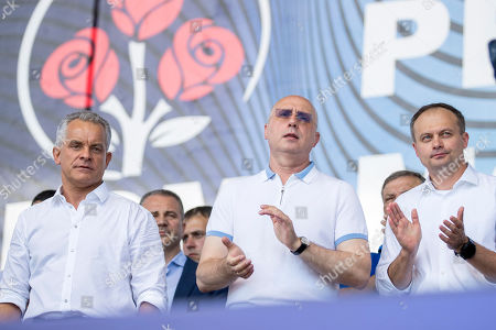 Stock Photo of The leader of the Democratic Party of Moldova Vladimir Plahotniuc (L) with the former prime minister of Moldova Pavel Filip (C) and former Speaker Andrian Candu (R) during the Democratic Party rally in Chisinau Moldova, 09 June 2019. After forming the majority on 08 June, the parliament voted the Socialist Zinaida Grecianii as Speaker and Maia Sandu as Prime Minister. The Democratic Party tries to mentain her position and power in old government, and uses the Constitutional Court to block all decision of new Government.
