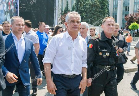The leader of the Democratic Party of Moldova Vladimir Plahotniuc (C) walks with his supporters during a protest in Chisinau Moldova, 09 June 2019. After forming the majority on 08 June, the parliament voted the Socialist Zinaida Grecianii as Speaker and Maia Sandu as Prime Minister. The Democratic Party tries to mentain her position and power in old government, and uses the Constitutional Court to block all decision of new Government.