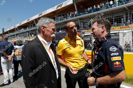 Formula One Group CEO Chase Carey (L) , Renault team principal Cyril Abiteboul (C) and Aston Martin Red Bull Racing Team Chief Christian Horner (R) chat on the grid before the 2019 Canada Formula One Grand Prix at the Gilles Villeneuve circuit in Montreal, Canada, 09 June 2019.