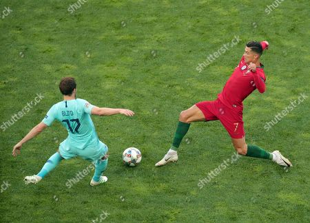 Netherlands' Daley Blind, left, duels for the ball with Portugal's Cristiano Ronaldo during the UEFA Nations League final soccer match between Portugal and Netherlands at the Dragao stadium in Porto, Portugal