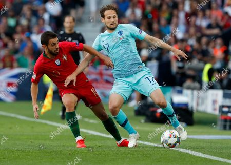 Netherlands' Daley Blind, right, takes the ball away from Portugal's Bernardo Silva during the UEFA Nations League final soccer match between Portugal and Netherlands at the Dragao stadium in Porto, Portugal