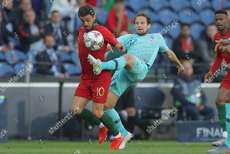 Bernardo Silva of Portugal and Daley Blind of Netherlands in action