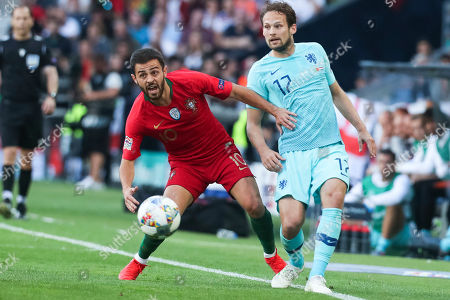 Portugal's Bernardo Silva (L) fights for the ball with Netherlands Daley Blind during the UEFA Nations League final soccer match Portugal vs Netherlands at Dragao stadium, Porto, Portugal, 09 June 2019.