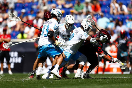 Atlas' Kevin Unterstein and Atlas' Trevor Baptiste battle for the ball with Chaos' Thomas Kelly during a Premier Lacrosse League game on in Harrison, N.J
