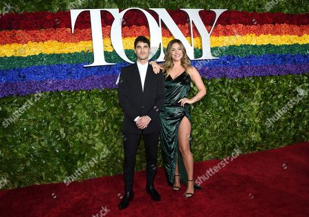 Darren Criss, Mia Swier. Darren Criss, left, and Mia Swier arrive at the 73rd annual Tony Awards at Radio City Music Hall, in New York