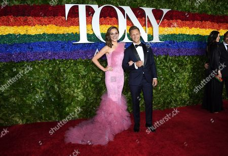 Laura Osnes, Nathan Johnson. Laura Osnes, left, and Nathan Johnson arrive at the 73rd annual Tony Awards at Radio City Music Hall, in New York