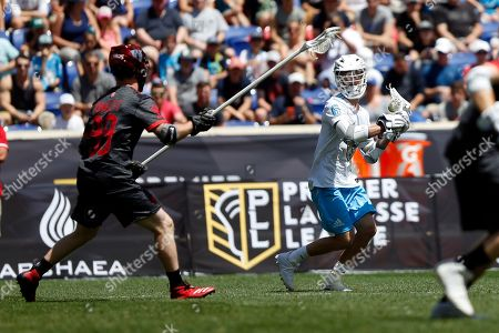 Atlas' Kieran McArdle carries the ball during a Premier Lacrosse League game against the Chaos on in Harrison, N.J