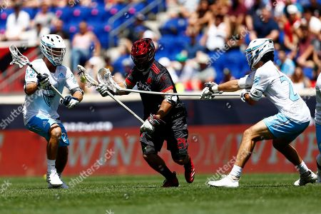 Stock Picture of Chaos' Thomas Kelly runs with the ball as Atlas' Ryan Conrad and Noah Richard defend during a Premier Lacrosse League game on in Harrison, N.J