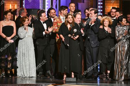 """Eva Price, center, and the cast and crew of """"Rodgers & Hammerstein's Oklahoma!""""accept the award for best revival of a musical at the 73rd annual Tony Awards at Radio City Music Hall, in New York"""