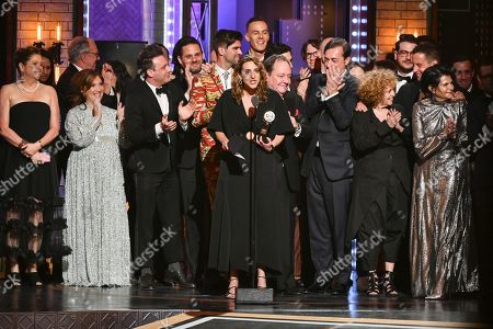 """Eva Price and the cast and crew of """"Rodgers & Hammerstein's Oklahoma!""""accept the award for best revival of a musical at the 73rd annual Tony Awards at Radio City Music Hall, in New York"""