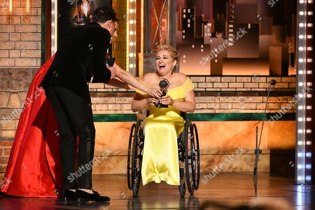 "Laura Benanti, Anthony Ramos. Laura Benanti, from left, and Anthony Ramos present the award for best performance by an actress in a featured role in a musical to Ali Stroker for her performance in ""Rodgers & Hammerstein's Oklahoma!"" at the 73rd annual Tony Awards at Radio City Music Hall, in New York"
