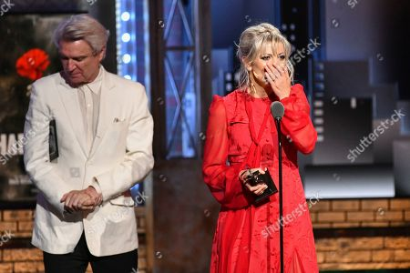 """Anais Mitchell, David Byrne. Anais Mitchell accepts the award for best original score for """"Hadestown"""" at the 73rd annual Tony Awards at Radio City Music Hall, in New York. At left is presenter David Byrne"""