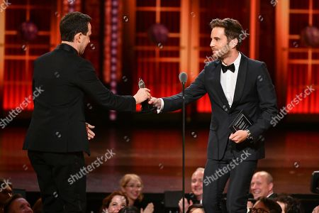 """Ben Platt, Santino Fontana. Ben Platt, left, presents the award for best performance by an actor in a leading role in a musical to Santino Fontana, for """"Tootsie,"""" at the 73rd annual Tony Awards at Radio City Music Hall, in New York"""
