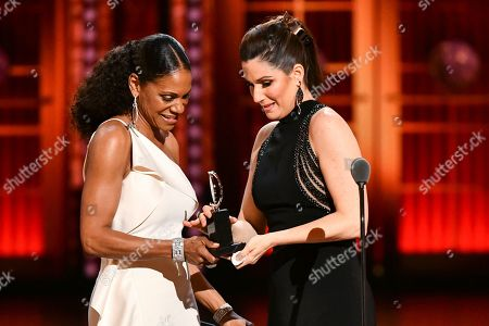 "Audra McDonald, Stephanie J. Block. Audra McDonald presents the award for best performance by an actress in a leading role in a musical to Stephanie J. Block for ""The Cher Show"" at the 73rd annual Tony Awards at Radio City Music Hall, in New York"