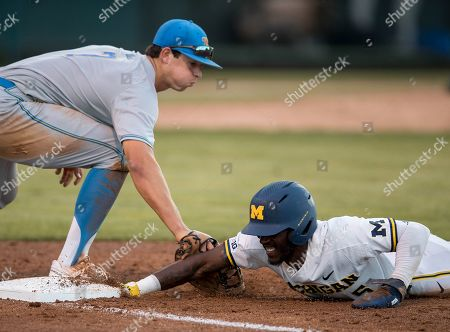 Los Angeles, CA..Michigan outfielder (5) Christian Bullock slides back into first base during an NCAA super regional game between the Michigan Wolverines and the UCLA Bruins at Jackie Robinson Stadium in Los Angeles, California. UCLA defeated Michigan 5-4. .(Mandatory Credit: Juan Lainez / MarinMedia.org / Cal Sport Media)