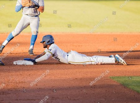 Los Angeles, CA..Michigan outfielder (5) Christian Bullock slides into second base during an NCAA super regional game between the Michigan Wolverines and the UCLA Bruins at Jackie Robinson Stadium in Los Angeles, California. UCLA defeated Michigan 5-4. .(Mandatory Credit: Juan Lainez / MarinMedia.org / Cal Sport Media)