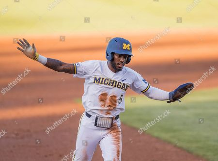 Los Angeles, CA..Michigan outfielder (5) Christian Bullock celebrates going around the bases after his teammate hit a homerun during an NCAA super regional game between the Michigan Wolverines and the UCLA Bruins at Jackie Robinson Stadium in Los Angeles, California. UCLA defeated Michigan 5-4. .(Mandatory Credit: Juan Lainez / MarinMedia.org / Cal Sport Media)