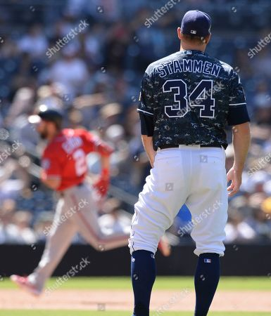 San Diego Padres relief pitcher Craig Stammen looks on from the mound after giving up a home run to Washington Nationals right fielder Adam Eaton, left, during the eighth inning of a baseball game, in San Diego