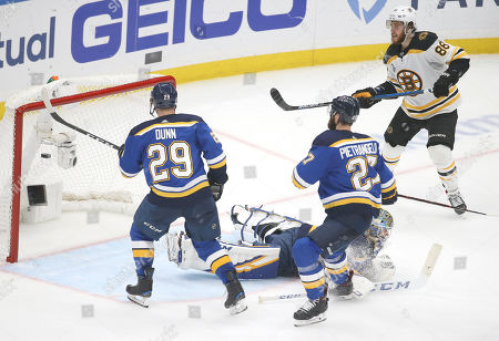 Boston Bruins right wing David Pastrnak (88), of the Czech Republic, scores a goal against St. Louis Blues goaltender Jordan Binnington and defenders Vince Dunn (29) and Alex Pietrangelo (27) during the third period of Game 6 of the NHL hockey Stanley Cup Final, in St. Louis. The Bruins won 5-1 to even the series 3-3