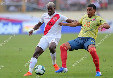 Stock Picture of Colombia's Roger Martinez (L) vies for the ball with Peru's Carlos Caceda during an international friendly soccer match between Peru and Colombia at Monumental U stadium in Lima, Peru, 09 June 2019.