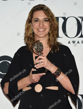 """Stock Photo of Eva Price poses in the press room with the award for best revival of a musical for """"Rodgers & Hammerstein's Oklahoma!"""" at the 73rd annual Tony Awards, in New York"""